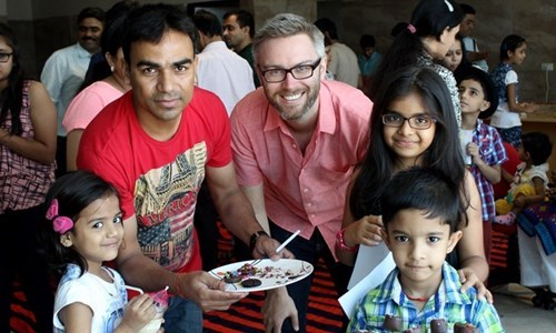 Ryan H. and our India country team at a family fun event in Delhi, India